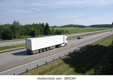 clean white truck driving past, elevated view from above