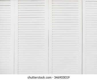 Clean white wooden shutters blinders doors texture background.