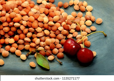 cleaned cherry stones on stone background