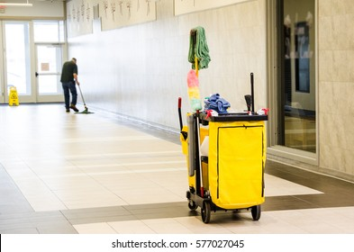 Cleaner is cleaning the floor, cleaning trolley