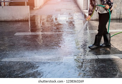 cleaner maid woman cleaning the outdoor floor