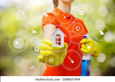 Cleaner shows the model of a house on blurred background .