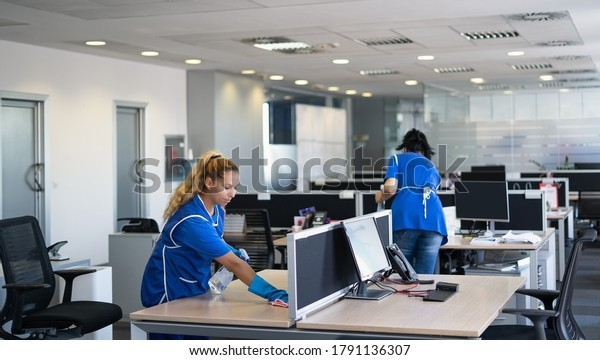 Cleaners clean empty office space photo