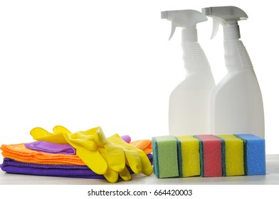 Cleaners, sponges, rags and rubber gloves on a white background