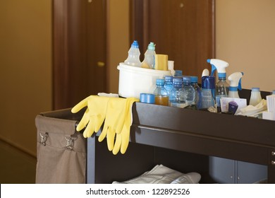 Cleaners trolley with cleaning equipments at hotel