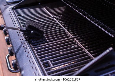 Cleaning BBQ grill for grilling meats.