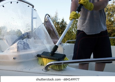 Cleaning boat with brush