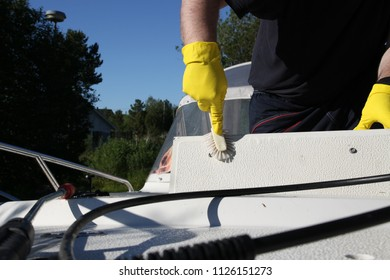 Cleaning boat with small brush