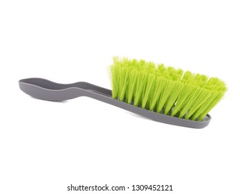 cleaning brush isolated on white. Green brush isolated on white background