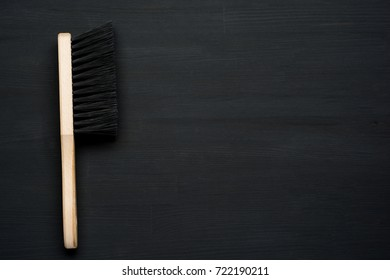 cleaning brush on dark wooden background with copy space