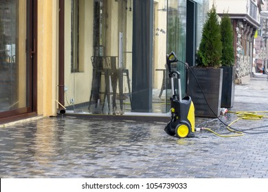 Cleaning, cleaning of building facades with a mini car wash