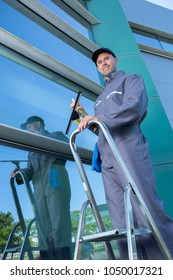 cleaning building glass walls