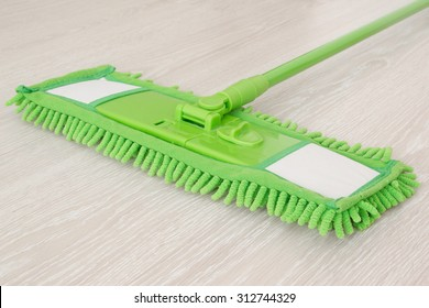 Cleaning by use modern mop on laminated floor