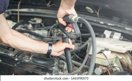 Cleaning car engine. Car detailing maintenance
