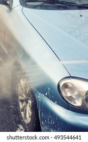 Cleaning car using high pressure water. Washing
