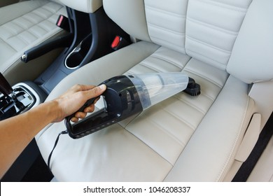 Cleaning a car using a vacuum cleaner