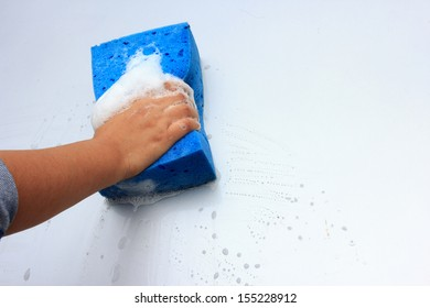 cleaning car wash with a sponge