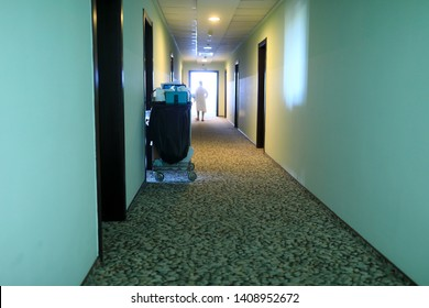 Cleaning cart in hotel corridor in morning