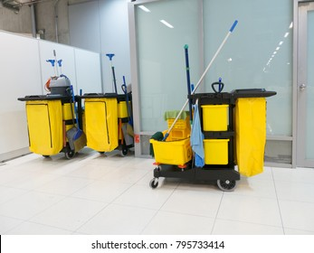 Cleaning Cart in the station. Cleaning tools cart and Yellow mop bucket wait for cleaning.Bucket and set of cleaning equipment in the airport office.