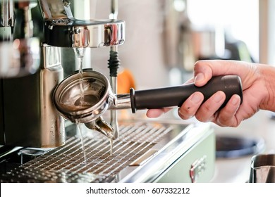 cleaning coffee machine in coffee shop