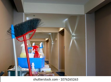 Cleaning concept: Hotel hallway with cleaners cart with cleaning equipment