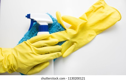 Cleaning concept in office, home Cleaning agent, rag glove on white background