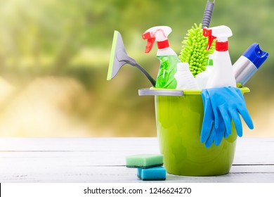 Cleaning concept of cleaning supplies needed to spring cleaning. Cleaning equipment at spring background.