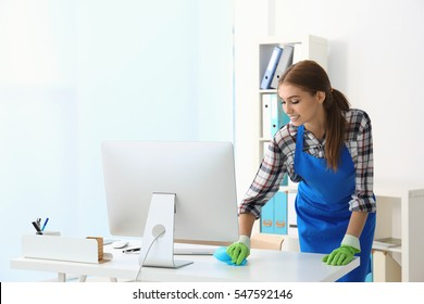 Cleaning concept. Young woman cleaning office