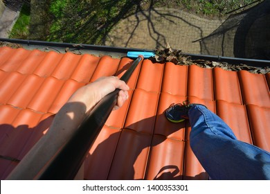 Cleaning of a Copper Rain Gutter by a Telescope Brush