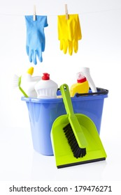 cleaning detergents in blue bucket and washing gloves