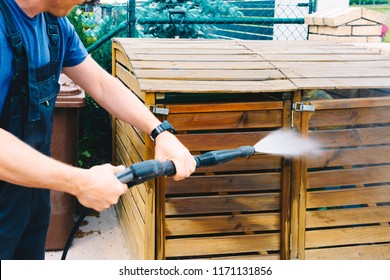 cleaning dirty wooden garden garbage with a high-pressure cleaner