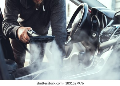 cleaning and disinfecting by steam of the car interior and a  car seats with a steam cleaner