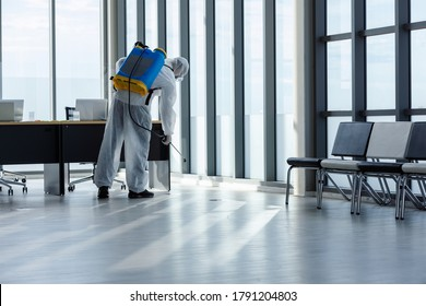 Cleaning and Disinfection at office amid the coronavirus epidemic Professional teams for disinfection efforts Infection prevention and control of epidemic Protective suit and mask.