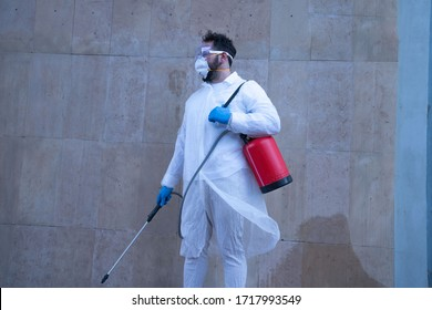 Cleaning and Disinfection on the playground in the city complex amid the coronavirus epidemic.Professional team for disinfection efforts Infection control of epidemic Protective suit, mask, spray bag.