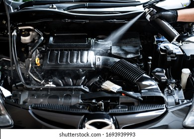 Cleaning the engine bay. Car cleaning and car detailing concept.