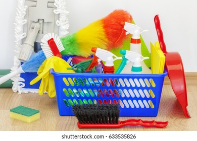 Cleaning equipment in basket with mop behind