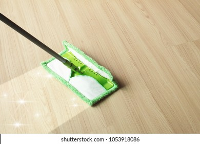 Cleaning floor with mop on laminate floor