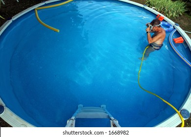 cleaning the garden swimming pool