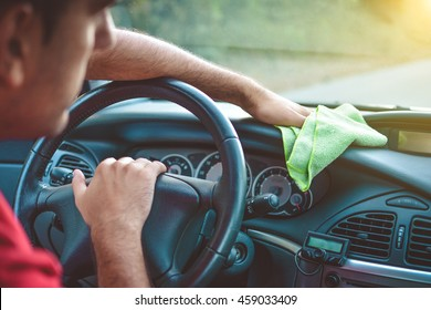 Cleaning with green microfiber cloth polishing car, interior concept