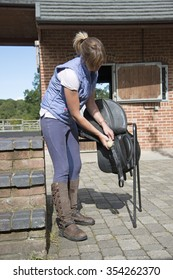 cleaning a horse's saddle