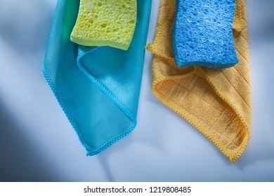 Cleaning household washcloth sponges on white surface.