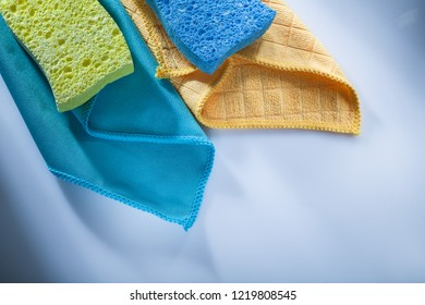 Cleaning household washcloth sponges on white background.