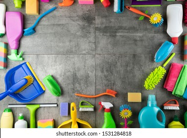 Cleaning and housekeeping concept. Gray tiles background.