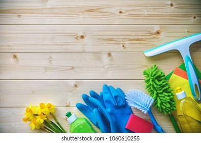 Cleaning items on wooden background