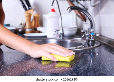 Cleaning Kitchen With Sponge