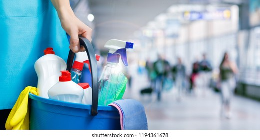 Cleaning lady with cleaning products on blurred background.