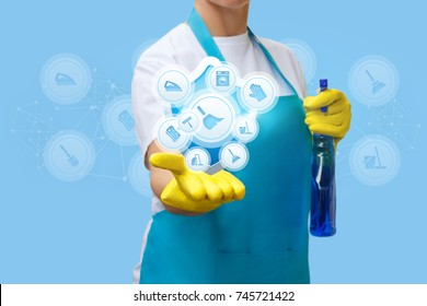 Cleaning lady shows cleaning services and work at home.