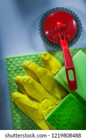 Cleaning metallic brush washcloth sponge protective gloves on white surface.
