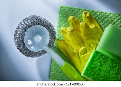 Cleaning metallic brush washcloth sponge safety gloves on white background.