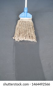 Cleaning mop and wet floor. Janitorial service.